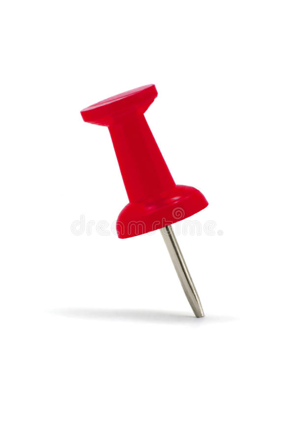 Rotes Thumbtack-Druckbolzen-Makro getrennt stockbild