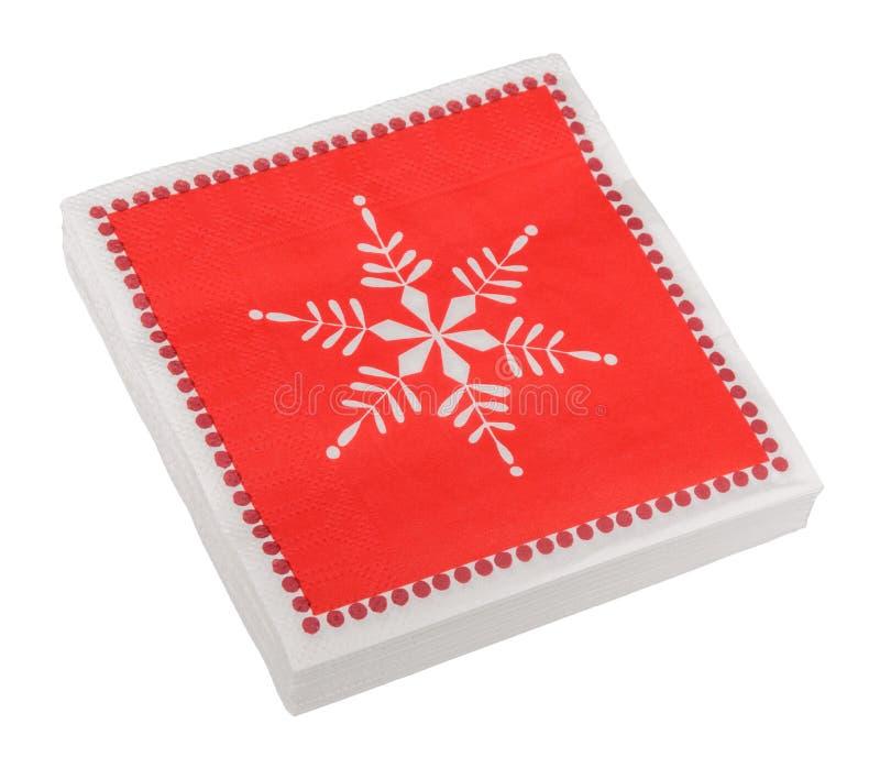 Rotes Weihnachten oder festliche Papierserviettenalias Servietten, lokalisiert stockfotografie