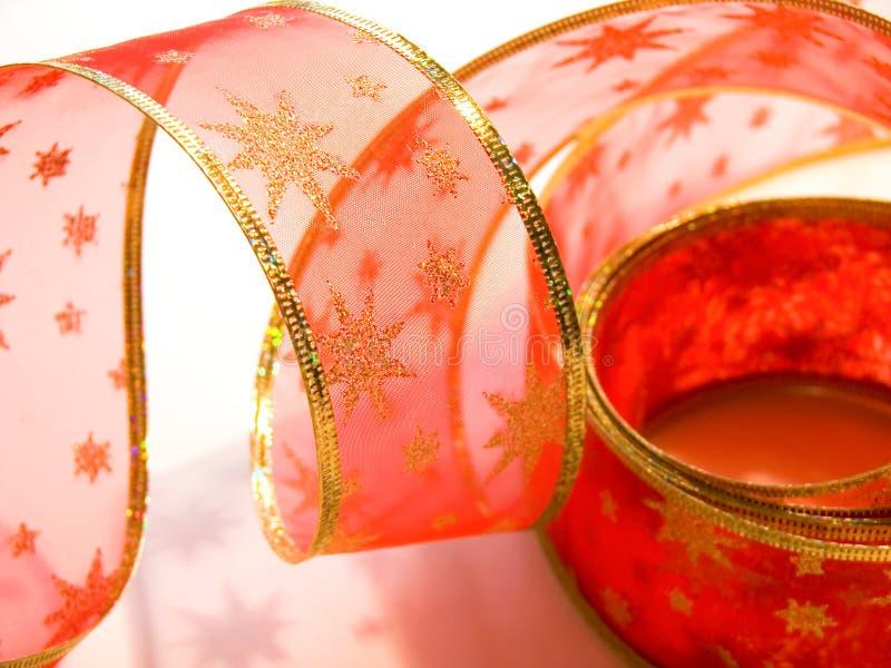 Rotes Weihnachtsfarbband stockfoto