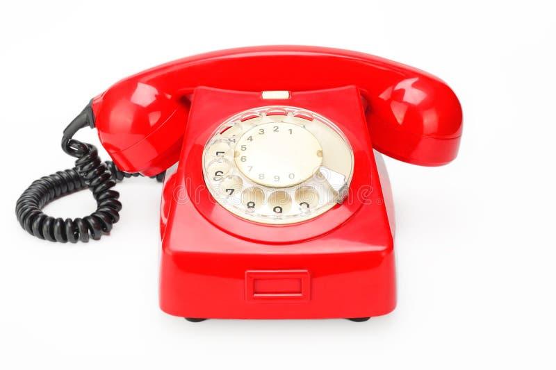 Rotes Weinlesetelefon auf einem weißen Hintergrund stockfotografie