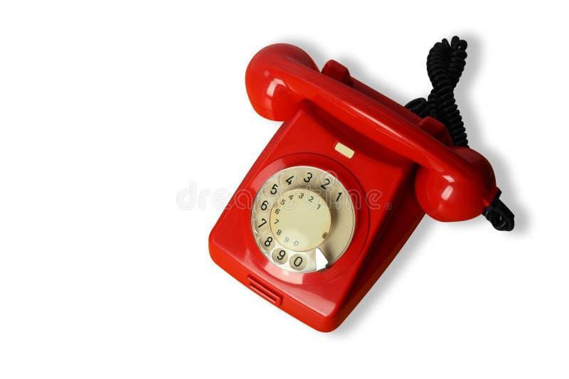 Rotes Weinlesetelefon auf einem weißen Hintergrund Getrennt stockfoto