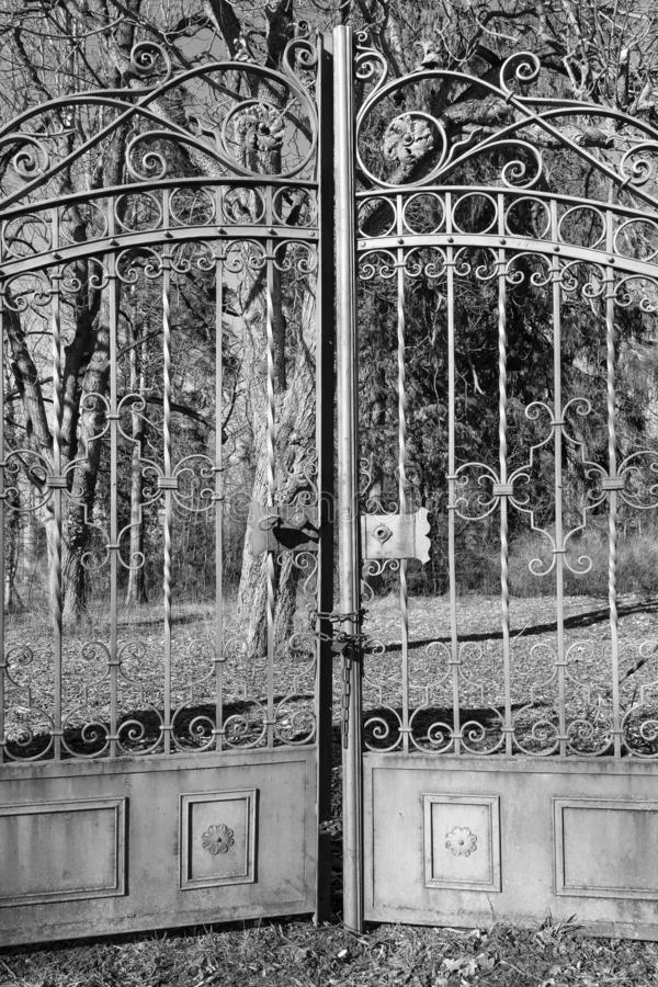 A garden gate, closed metal gate in the garden, Rothenburg ob der Tauber, Germany - 18 February 2019: The streets of Rothenburg. A garden gate, closed metal gate royalty free stock photo