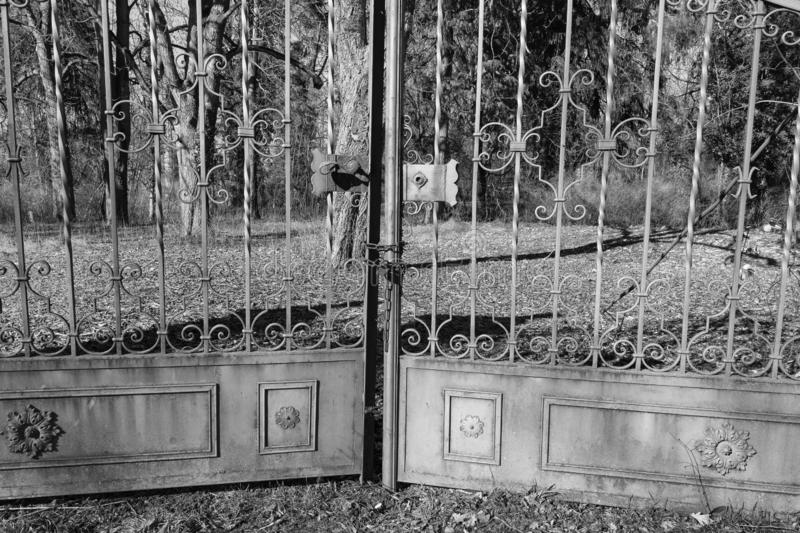 A garden gate, closed metal gate in the garden, Rothenburg ob der Tauber, Germany - 18 February 2019: The streets of Rothenburg. A garden gate, closed metal gate royalty free stock images