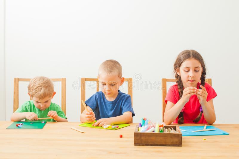 Rothers and sister together play and learn molding stock photo