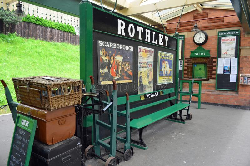 Rothley Station Platform and Ticket Office. Platform, luggage, bench, signage,k advertising and ticket office at Rothley Station. Rothley is a restored Edwardian royalty free stock photography