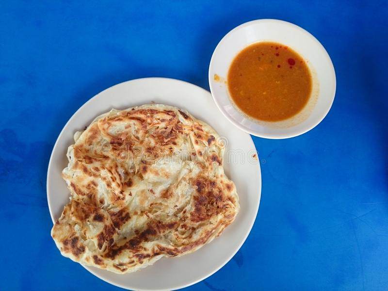 Roti canai with curry royalty free stock image