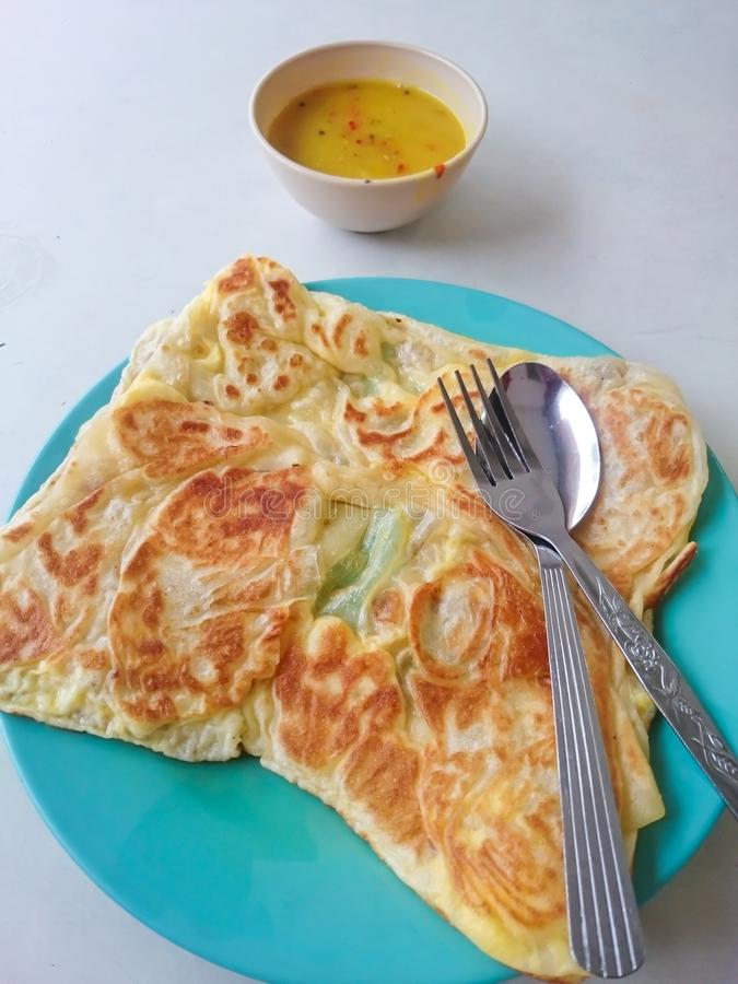 Roti canai. Served on plate. Malaysian most popular menu for breakfast royalty free stock images