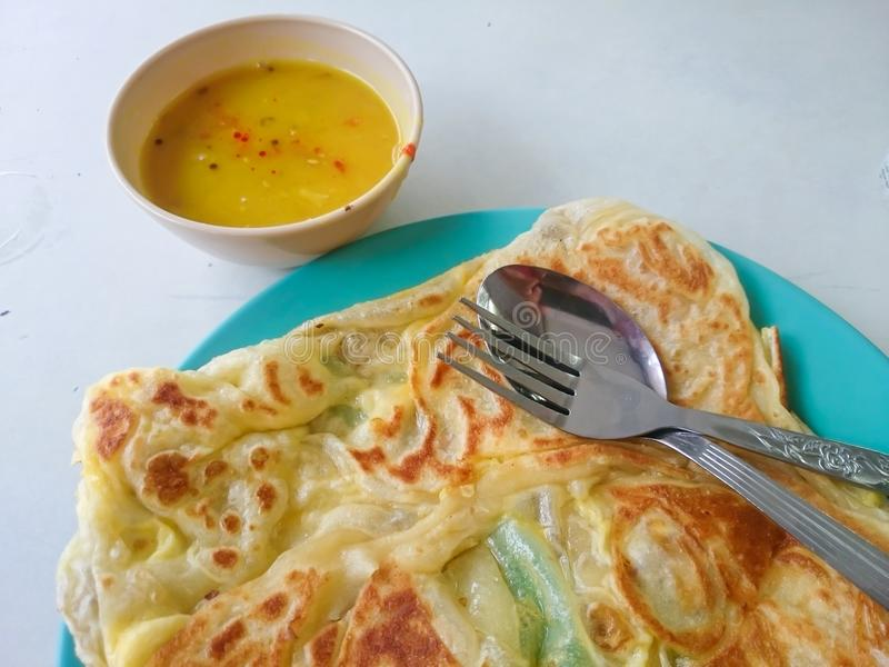Roti canai. Served on plate. Malaysian most popular menu for breakfast stock photography