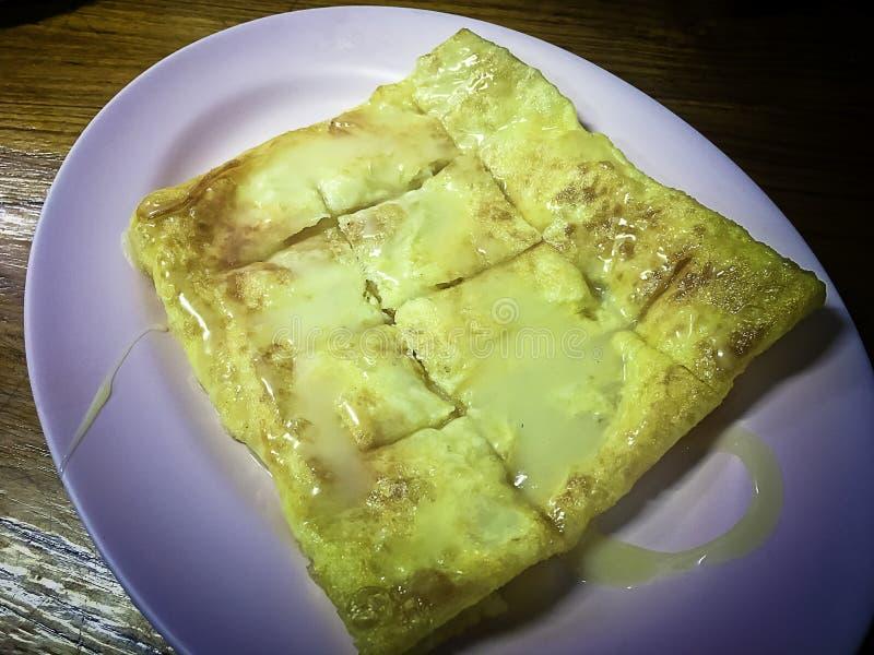 Roti with condensed milk and sugar. stock photo