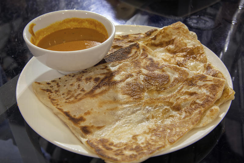 Roti Prata with Curry Gravy royalty free stock photos