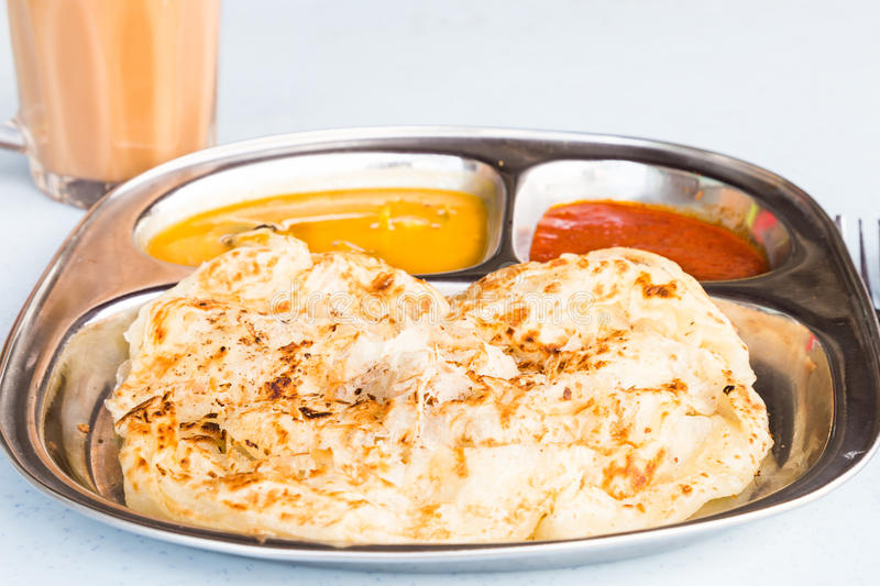 Roti Prata or Roti Canai, a traditional Indian bread served with curry stock image