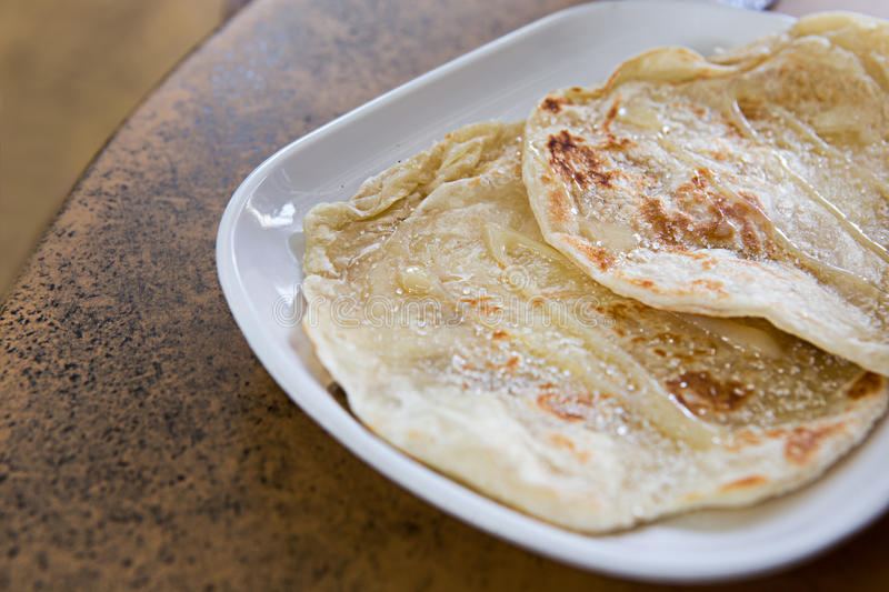 Roti with sweetened condensed milk and sugar royalty free stock image