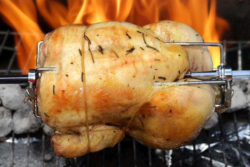Rotisserie chicken on the grill royalty free stock photo