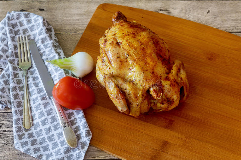 rotisserie chicken on wooden serving tray with stock photos