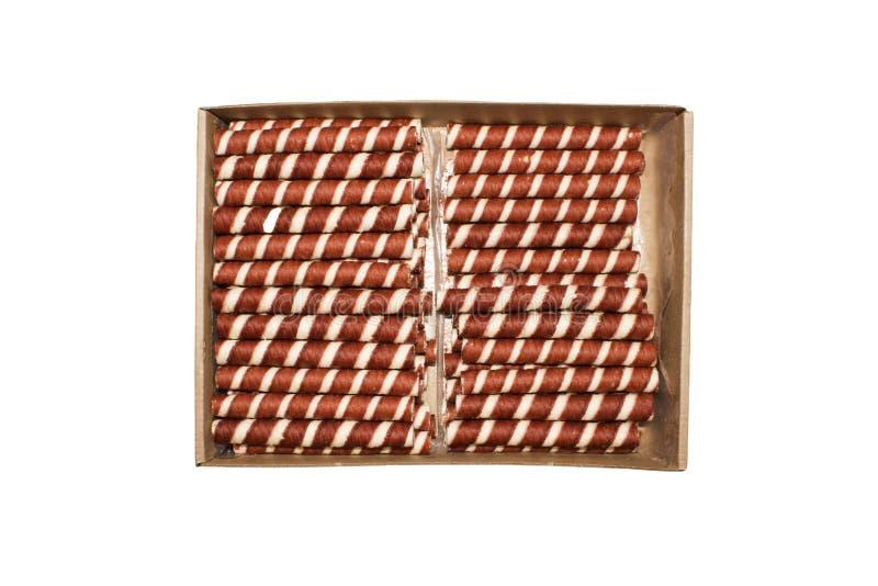Rotoli del wafer con il materiale da otturazione del cioccolato fotografia stock libera da diritti