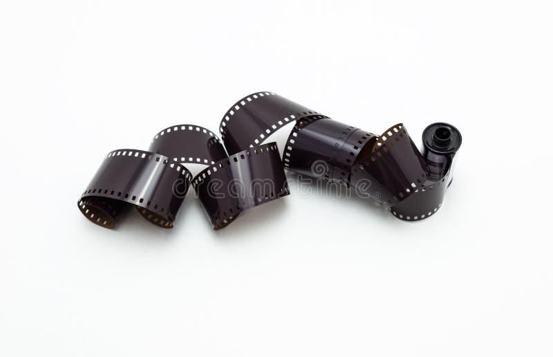 rotoli di film della foto di 35mm Isolato su priorità bassa bianca immagini stock libere da diritti