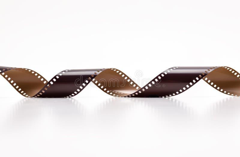 rotoli di film della foto di 35mm Isolato su priorità bassa bianca immagine stock libera da diritti