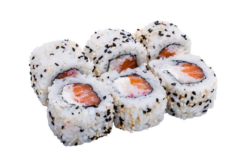 Rotoli di sushi con i semi di sesamo isolati su fondo bianco immagini stock libere da diritti