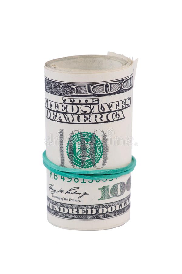 Rotolo del dollaro stretto con l'elastico verde fotografia stock