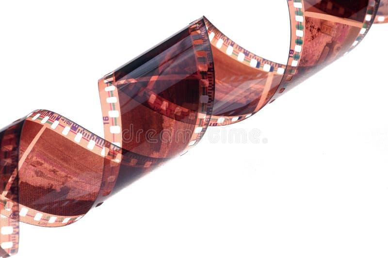 Rotolo della striscia di pellicola isolato su fondo bianco immagini stock