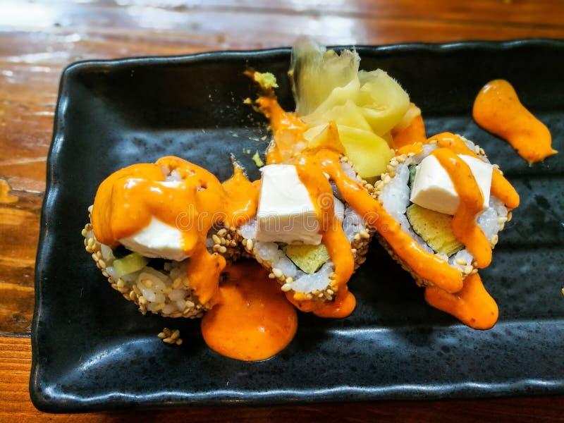 Rotolo di Salmon Skin Maki Sushi fotografia stock