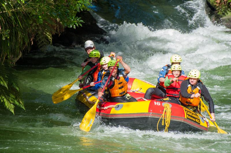 Tourists emerge paddling from a white water rafting course at Kaituna Cascades in Rotorua New Zealand royalty free stock photo