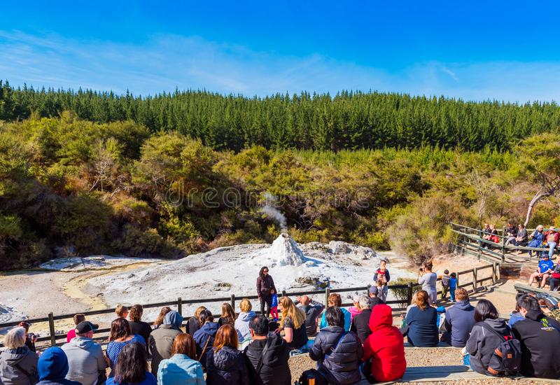 ROTORUA, NEW ZEALAND - OCTOBER 10, 2018: Crowds sitting to watch daily eruption of Lady Knox Geyser in Wai-o-Tapu stock image