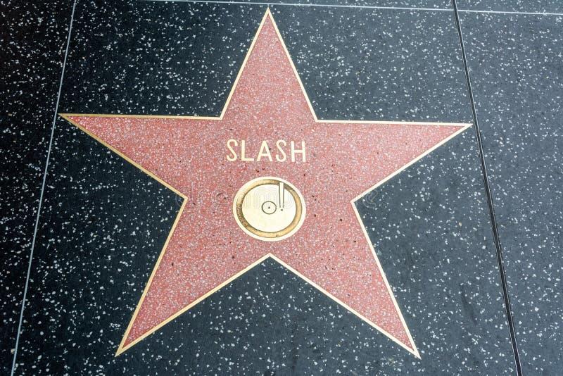 Rotsmusicus en songwriter de Schuine streep speelt op de Hollywood-Gang van Bekendheid in Los Angeles, CA mee stock afbeelding