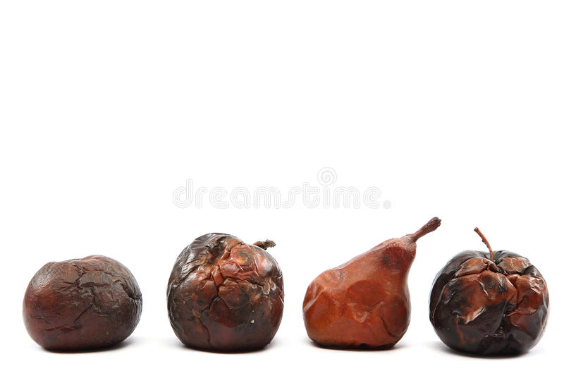 Rotten apples and pea on white background. Rotten apples and pear isolated on white background stock photography