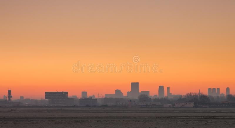 Rotterdam airport at sunrise. Rotterdam airport zestienhoven at sunrise with skyline of rotterdam in the background stock photos