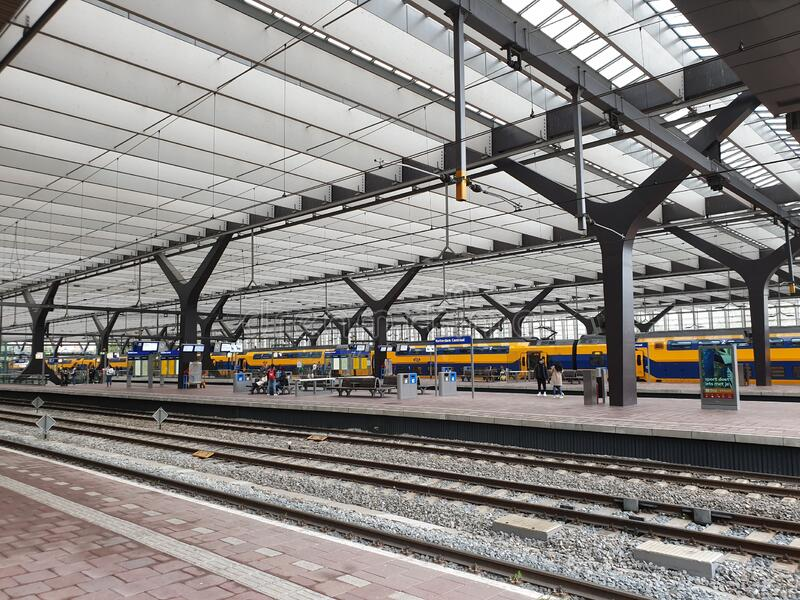 Rotterdam Centraal station with national and international trains with signs and platforms stock photos