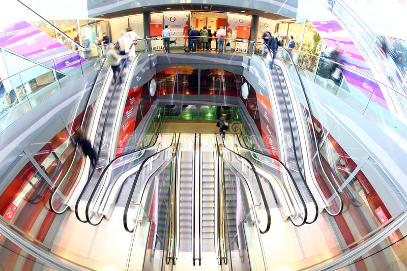 Shopping retail mall people Rotterdam escalator markethall people shopping in markthal modern shop busy shopping stock photo