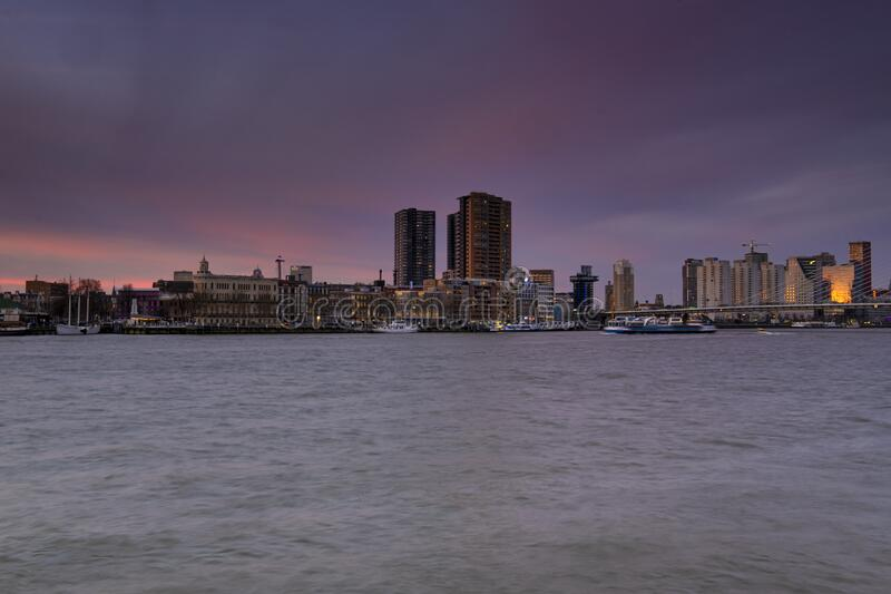 Rotterdam - 12 February 2019: Rotterdam, The Netherlands The skyline of Rotterdam at night, dusk. Maas canal on the. Foreground. Rotterdam, The Netherlands royalty free stock images