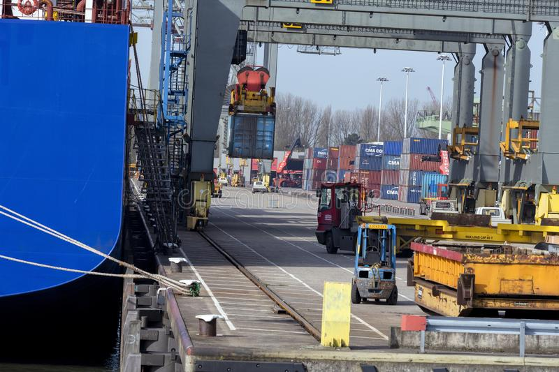 Rotterdam Harbour, 2018-04  Large Cargo container manipulation. Rotterdam, Netherlands 2018.  Freight being unloaded from a cargo ship and stored on the pier stock images