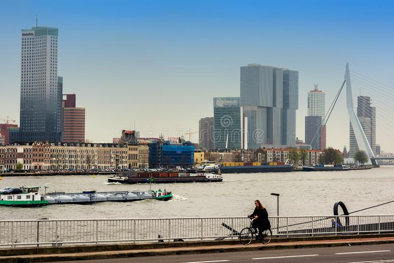 ROTTERDAM, NETHERLANDS - APRIL 13, 2018: Rotterdam embankment with `De Rotterdam` skyscraper and Erasmus bridge viewed from acro. Ss the river Nieuwe Maas royalty free stock photos