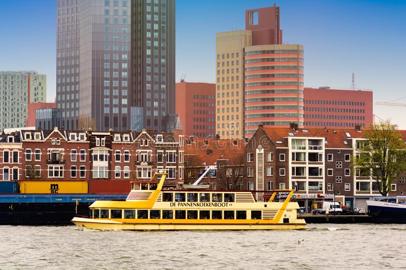 ROTTERDAM, NETHERLANDS - APRIL 13, 2018: Rotterdam embankment with skyscrapers and ships and the river Nieuwe Maas. Rotterdam is stock photo
