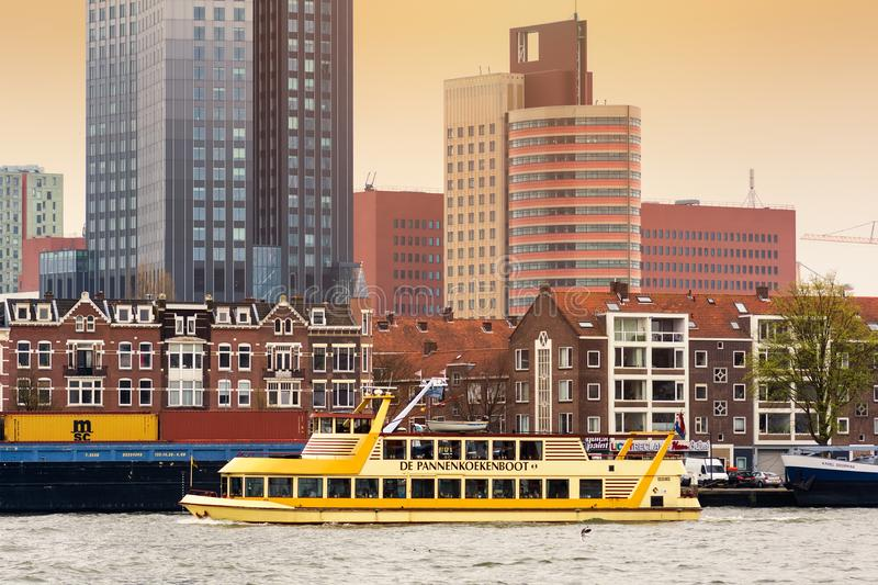 ROTTERDAM, NETHERLANDS - APRIL 13, 2018: Rotterdam embankment with skyscrapers and ships and the river Nieuwe Maas. Rotterdam is royalty free stock photo