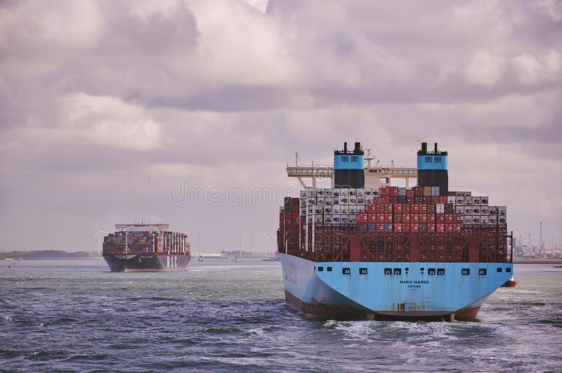 Two big container vessels in Rotterdam Channel royalty free stock photo