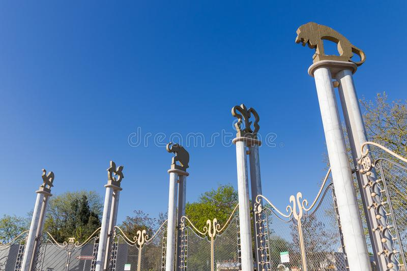Rotterdam,The Netherlands - may 2018: Old entrance of Rotterdam zoo, Blijdorp. Rotterdam,The Netherlands - may 2018: Columns with alimals of the old entrance of royalty free stock image