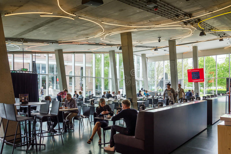 Rotterdam, Netherlands - May 9, 2015: People at Cafeteria of Kunsthal museum in Museumpark, Rotterdam. On May 9, 2015. The building was designed by the Dutch royalty free stock photography