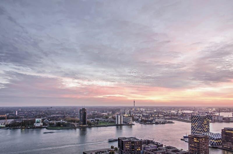 Spectacular sky over river, harbor and neighbourhoods. Rotterdam, The Netherlands, November 12, 2018: night falls over harbours and neighbourhoods on either side stock photos