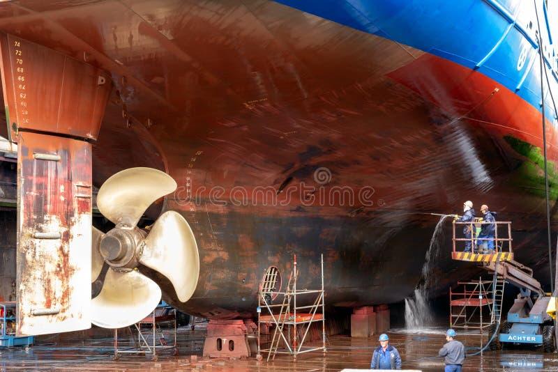 Ship repair dock workers stock photo