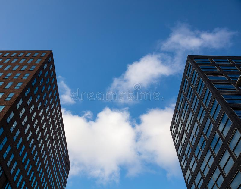 Rotterdam, Netherlands, skyscrapers against blue sky, background. Rotterdam in Netherlands. Low angle glass skyscrapers against blue sky, background royalty free stock photo