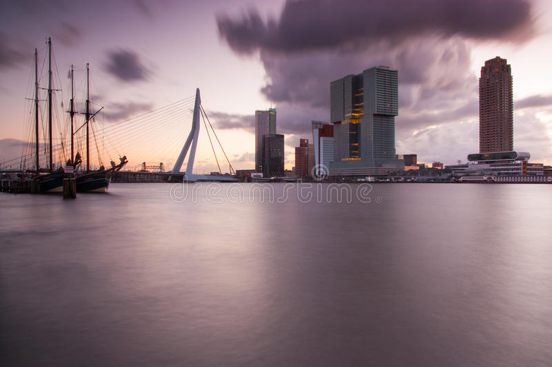 Rotterdam skyline at sunrise. Skyline of rotterdam with office buildings and cruise terminal at sunrise royalty free stock photo