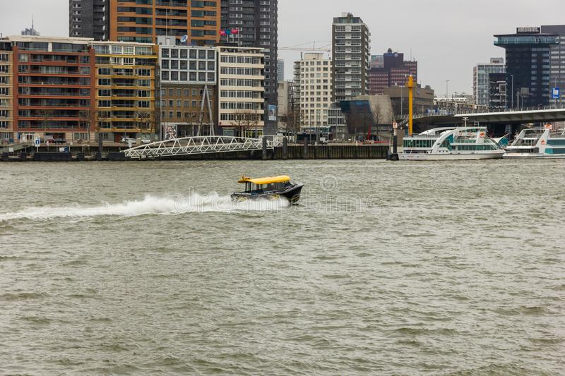 Rotterdam, South-Holland/the Netherlands - March 17 2018: Water Taxi roaring over the water stock image