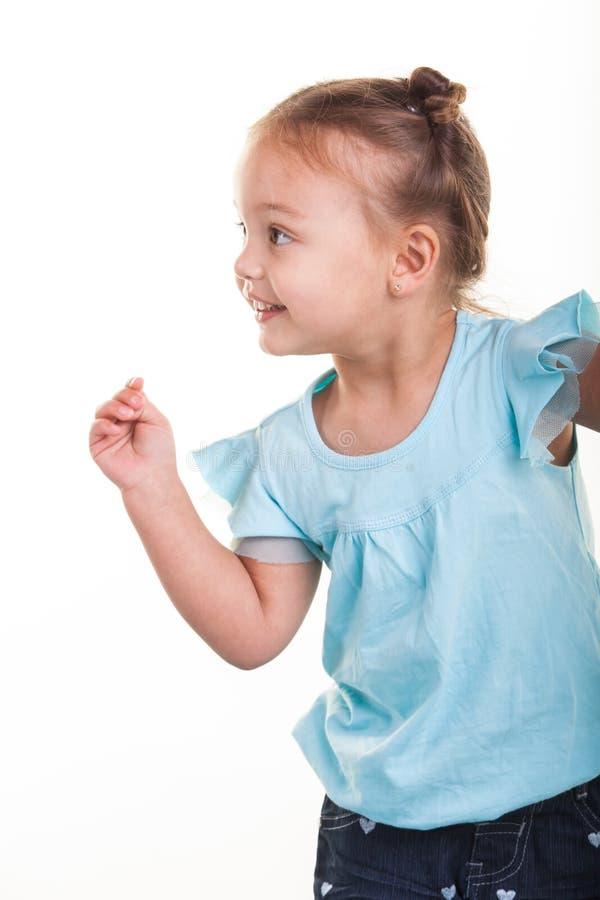 Rottura della bambina le sue dita immagine stock