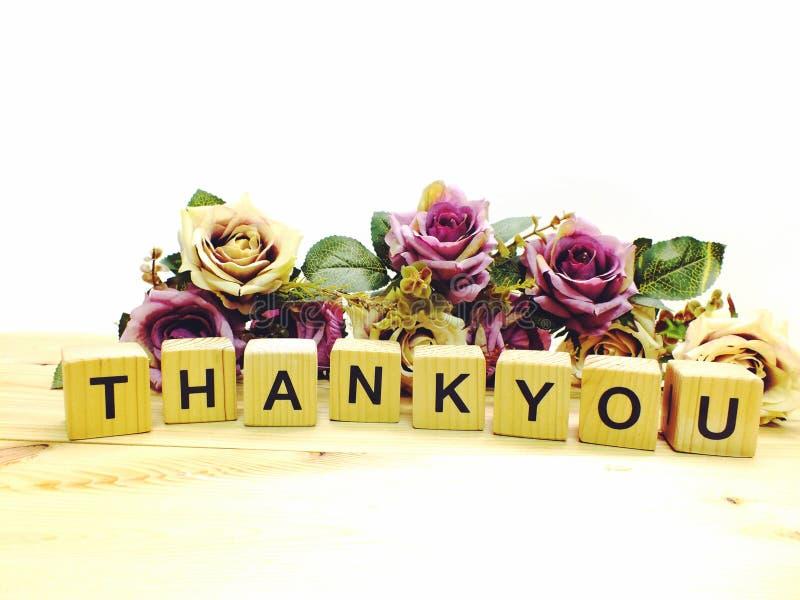 rotular agradece-lhe com o ramalhete das flores artificiais fotografia de stock royalty free
