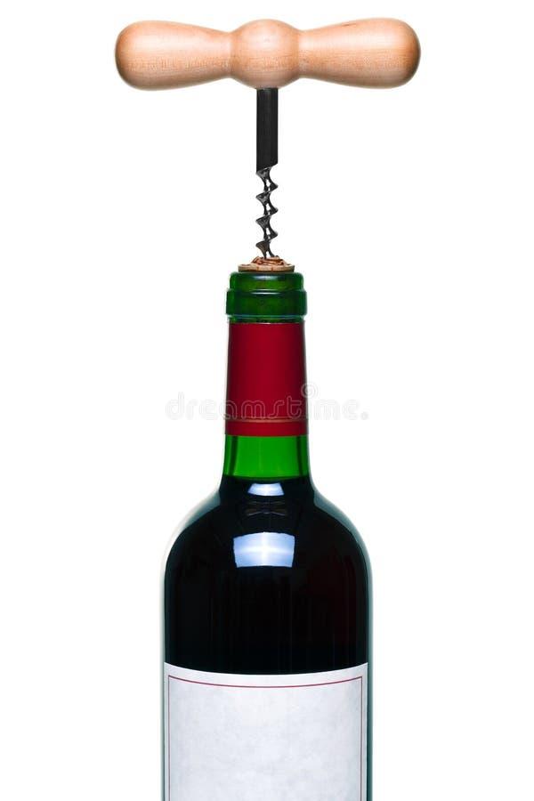 Rotweinflasche und -korkenzieher getrennt stockfotografie