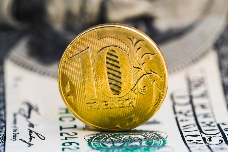 10 roubles against 100 dollars background stock image