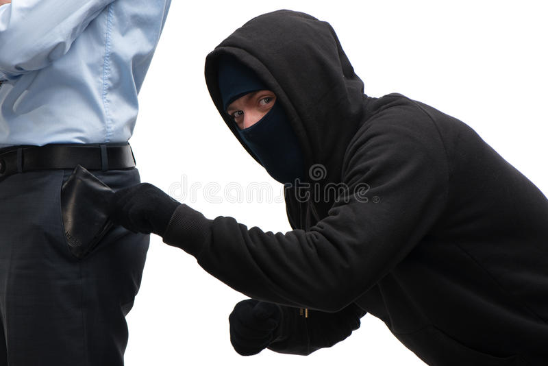 Roubo mascarado que tenta roubar a carteira fotos de stock royalty free
